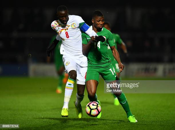 Cheikhou Kouyate of Senegal battles for the ball with Kelechi Iheanacho of Nigeria during the International Friendly match between Nigeria and...