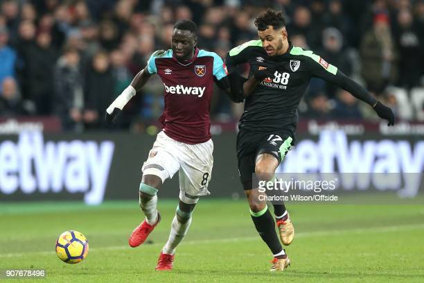 Cheikhou Kouyate of West Ham and Joshua King of Bournemouth battle for the ball during the Premier League match between West Ham United and AFC...