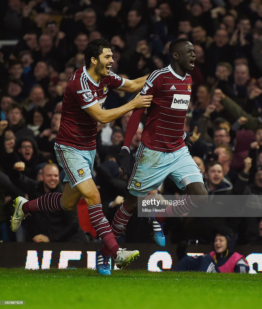 Cheikhou Kouyate of West Ham celebrates scoring the opening goal with James Tomkins of West Ham during the Barclays Premier League match between West Ham United and Manchester United at Boleyn Ground on February 8, 2015 in London, England.