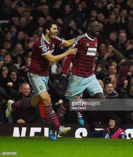 Cheikhou Kouyate of West Ham celebrates scoring the opening goal with James Tomkins of West Ham during the Barclays Premier League match between West...