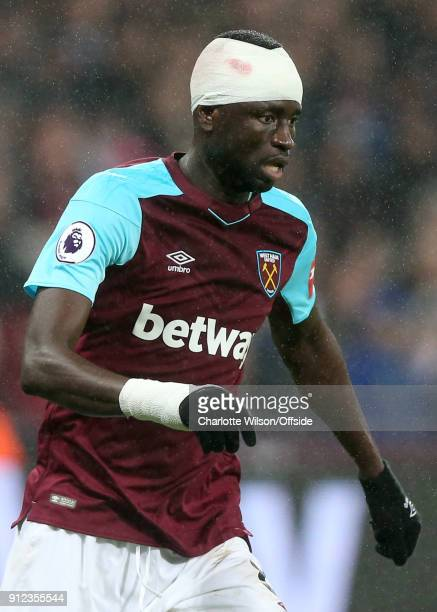 Cheikhou Kouyate of West Ham head bandaged due to an earlier injury during the Premier League match between West Ham United and Crystal Palace at...