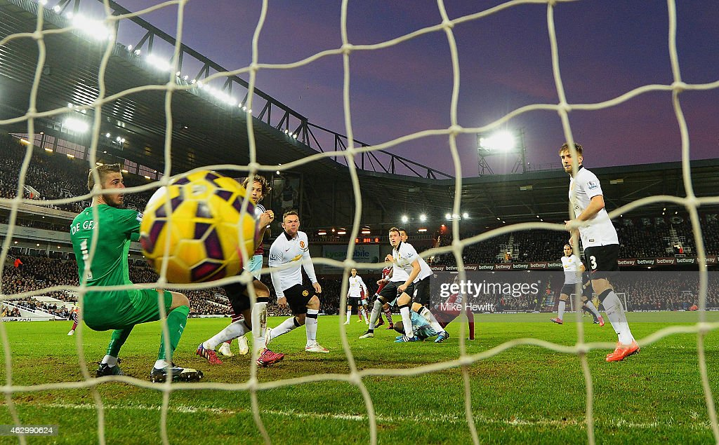 Cheikhou Kouyate of West Ham scores the opening goal past David De Gea of Manchester United during the Barclays Premier League match between West Ham United and Manchester United at Boleyn Ground on February 8, 2015 in London, England.