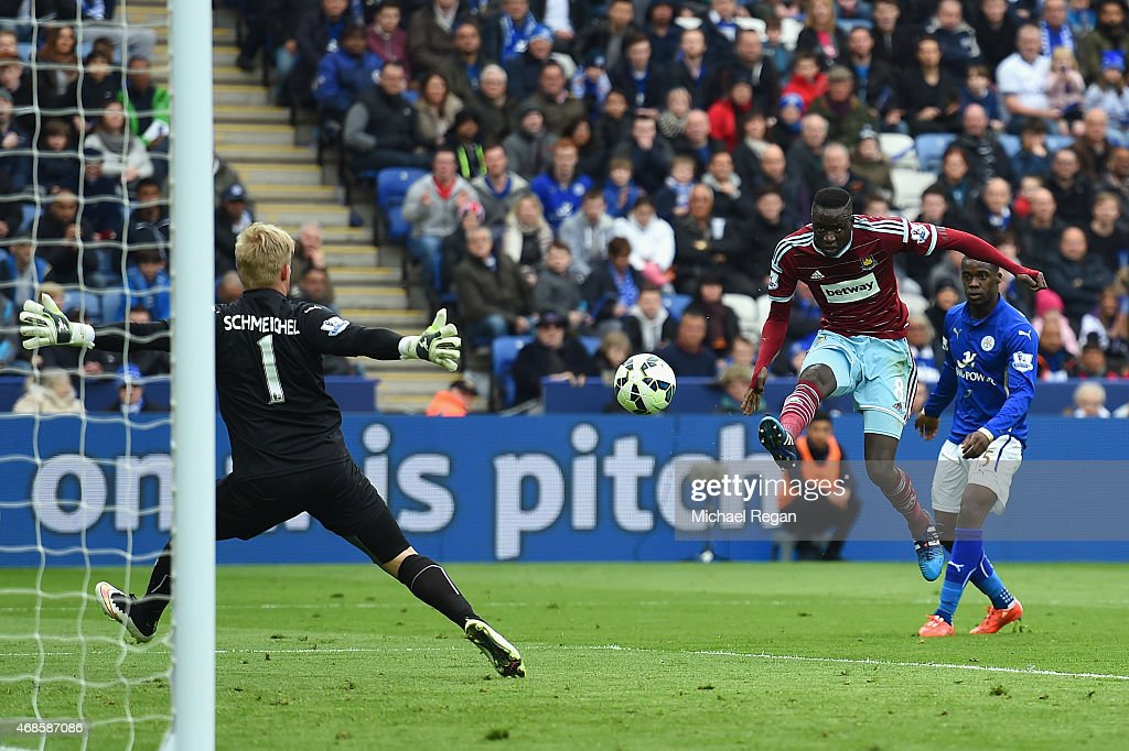 Cheikhou Kouyate of West Ham scores their first goal past Kasper Schmeichel of Leicester City during the Barclays Premier league match Leicester City and West Ham United at The King Power Stadium on April 4, 2015 in Leicester, England.