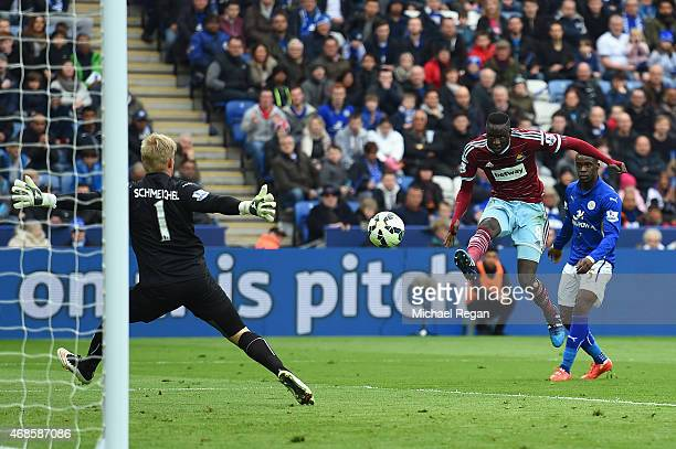 Cheikhou Kouyate of West Ham scores their first goal past Kasper Schmeichel of Leicester City during the Barclays Premier league match Leicester City...