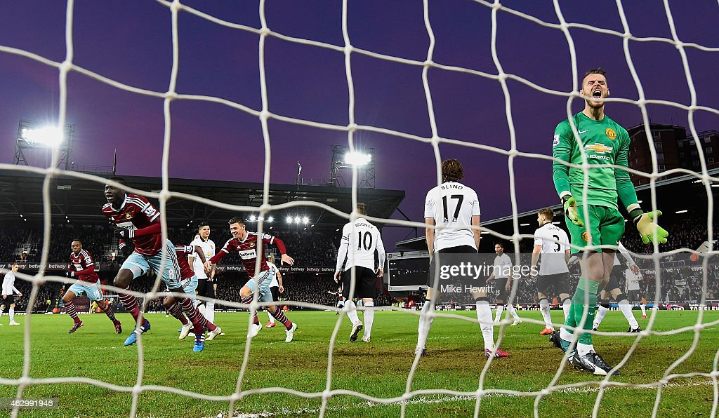 Cheikhou Kouyate of West Ham turns to celebrate scoring the opening goal past David De Gea of Manchester United (R) during the Barclays Premier League match between West Ham United and Manchester United at Boleyn Ground on February 8, 2015 in London, England.