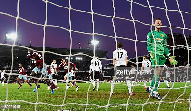 Cheikhou Kouyate of West Ham turns to celebrate scoring the opening goal past David De Gea of Manchester United during the Barclays Premier League...