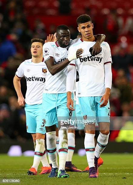 Cheikhou Kouyate of West Ham United and Ashley Fletcher of West Ham United embrace after the final whistle during the Premier League match between...