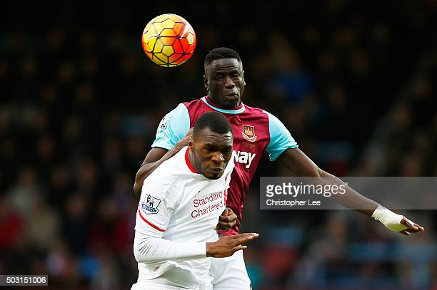 Cheikhou Kouyate of West Ham United and Christian Benteke of Liverpool compete for the ball during the Barclays Premier League match between West Ham...