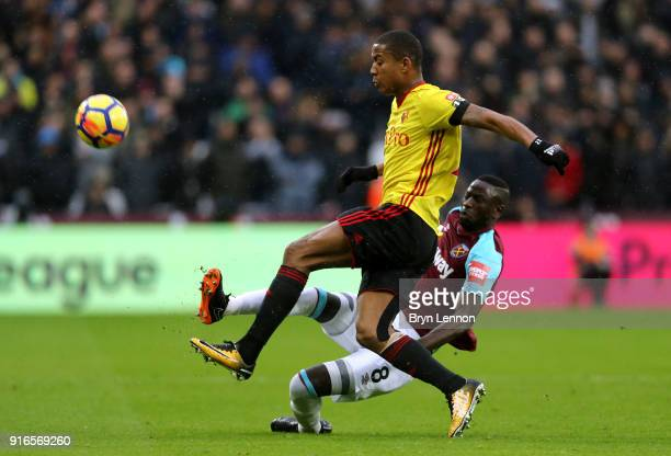 Cheikhou Kouyate of West Ham United and Marvin Zeegelaar of Watford battle for the ball during the Premier League match between West Ham United and...