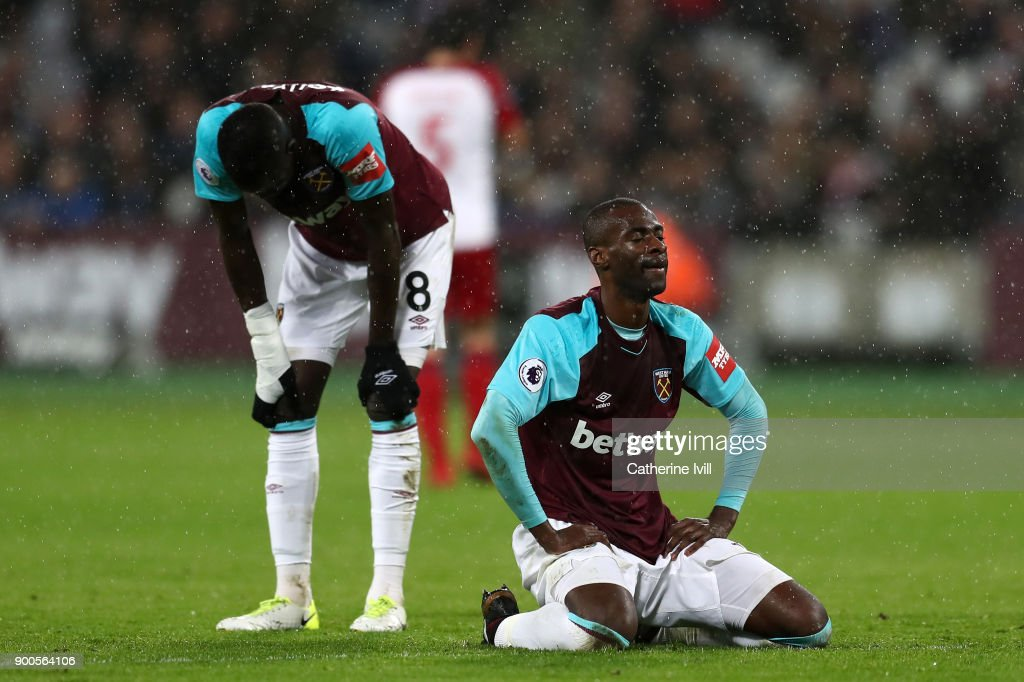 Cheikhou Kouyate of West Ham United and Pedro Obiang of West Ham United look dejeted during the Premier League match between West Ham United and West Bromwich Albion at London Stadium on January 2, 2018 in London, England.