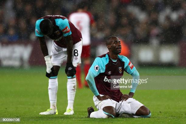 Cheikhou Kouyate of West Ham United and Pedro Obiang of West Ham United look dejeted during the Premier League match between West Ham United and West...
