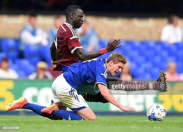 Cheikhou Kouyate of West Ham United and Teddy Bishop of Ipswich Town in action during the preseason friendly match between Ipswich Town and West Ham...
