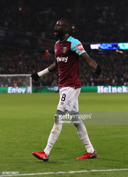 Cheikhou Kouyate of West Ham United celebrates as he scores their first and equalising goal during the Premier League match between West Ham United...
