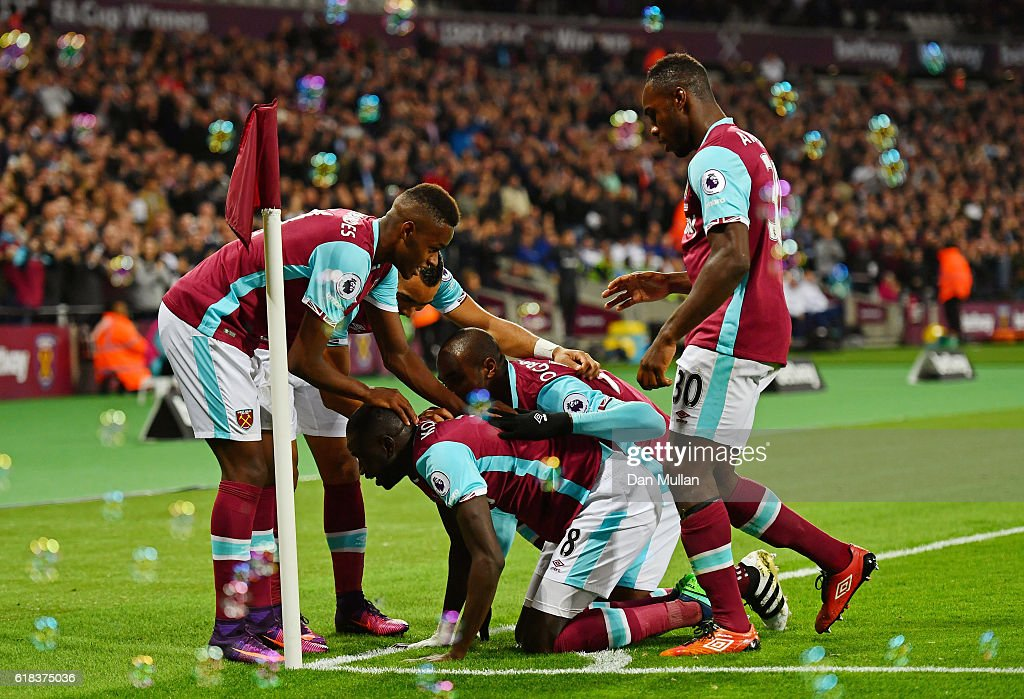 Cheikhou Kouyate of West Ham United (R) celebrates scoring his sides first goal with his West Ham United team matesduring the EFL Cup fourth round match between West Ham United and Chelsea at The London Stadium on October 26, 2016 in London, England.