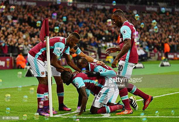 Cheikhou Kouyate of West Ham United celebrates scoring his sides first goal with his West Ham United team matesduring the EFL Cup fourth round match...