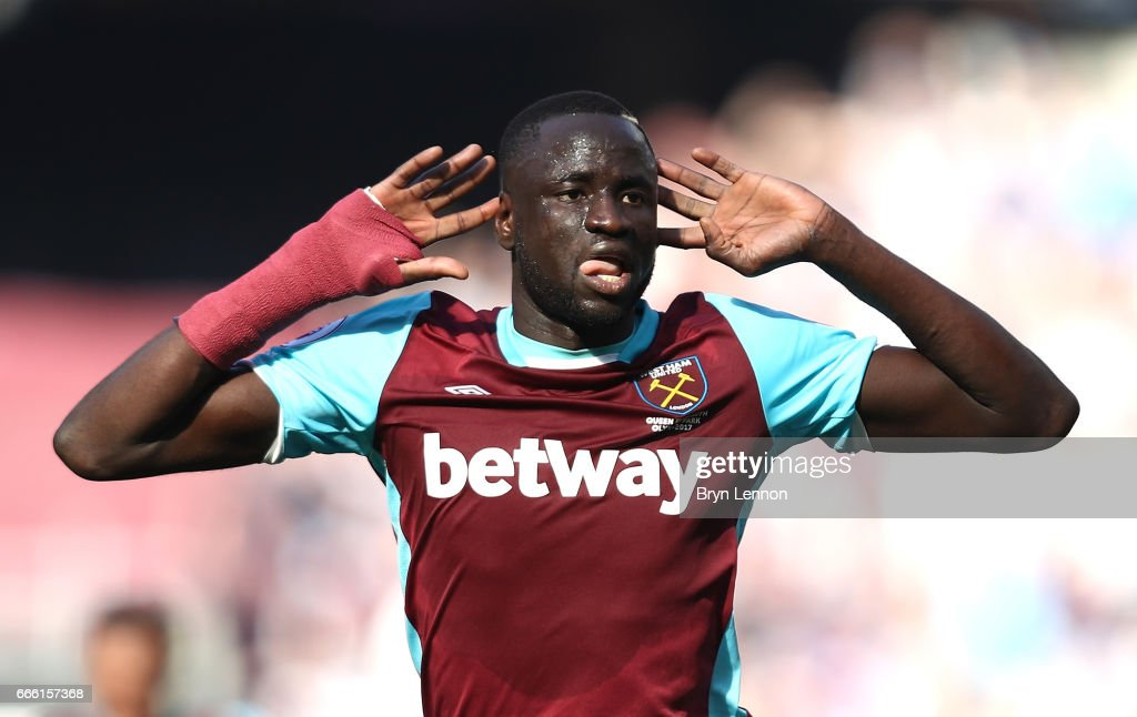 Cheikhou Kouyate of West Ham United celebrates scoring his sides first goal during the Premier League match between West Ham United and Swansea City at London Stadium on April 8, 2017 in Stratford, England.