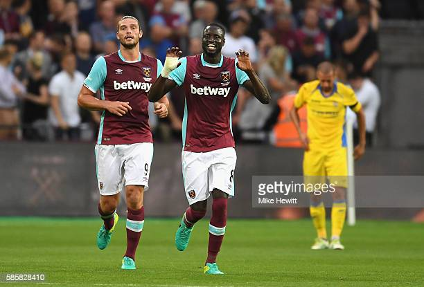 Cheikhou Kouyate of West Ham United celebrates with Andy Carroll after he scores his and his sides second goal during the UEFA Europa League...