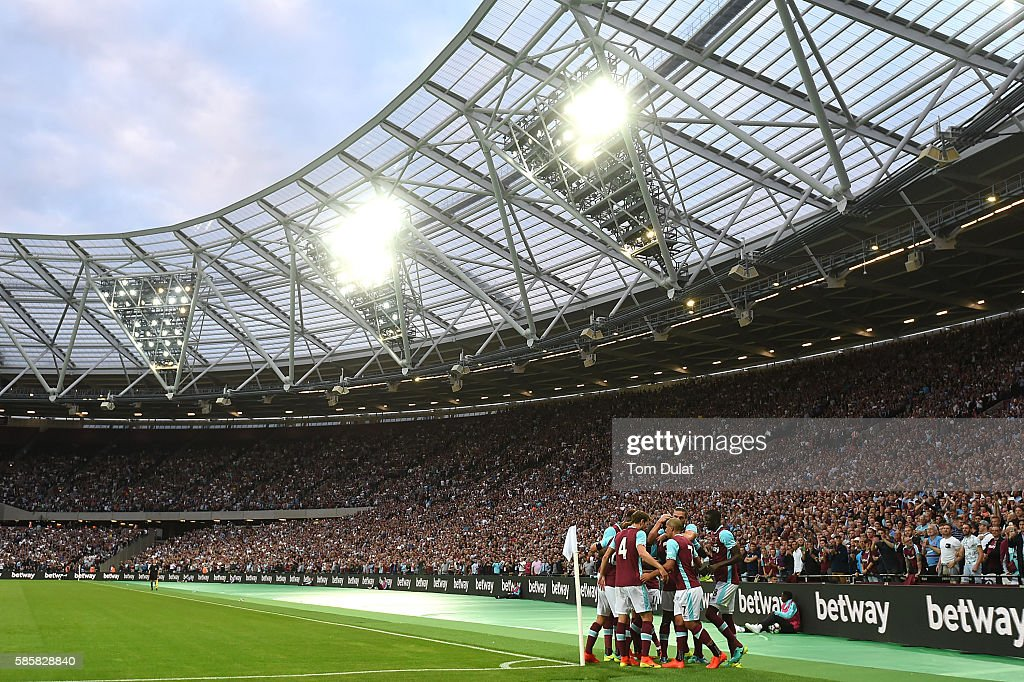 Cheikhou Kouyate of West Ham United celebrates with the team scoring the second goal during the UEFA Europa League Qualification round match between West Ham United and NK Domzale at London Stadium on August 4, 2016 in Stratford, England.