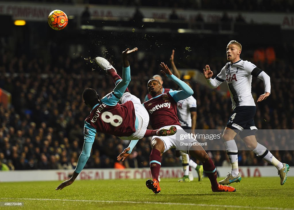 Cheikhou Kouyate of West Ham United performs an acrobatic shot on goal during the Barclays Premier League match between Tottenham Hotspur and West Ham United at White Hart Lane on November 22, 2015 in London, England.