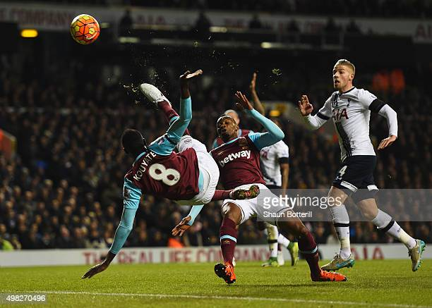 Cheikhou Kouyate of West Ham United performs an acrobatic shot on goal during the Barclays Premier League match between Tottenham Hotspur and West...
