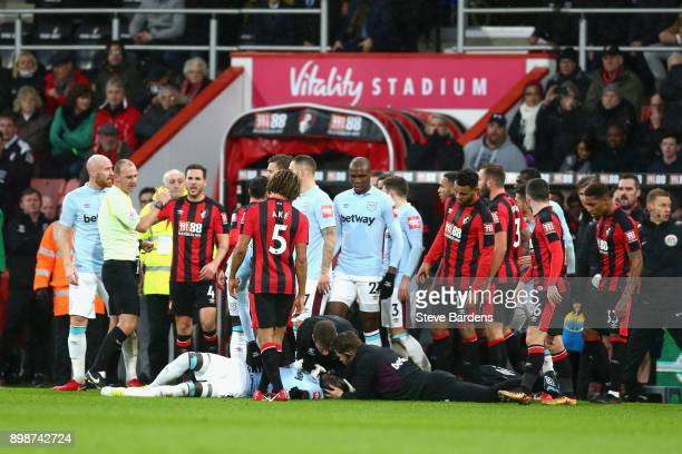Cheikhou Kouyate of West Ham United receives treatment from the medical team during the Premier League match between AFC Bournemouth and West Ham...