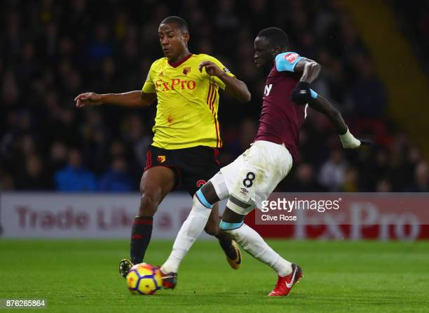 Cheikhou Kouyate of West Ham United shoots as Marvin Zeegelaar of Watford challenges during the Premier League match between Watford and West Ham...