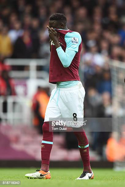 Cheikhou Kouyate of West Ham United walks off the pitch after shown a red card during the Barclays Premier League match between West Ham United and...