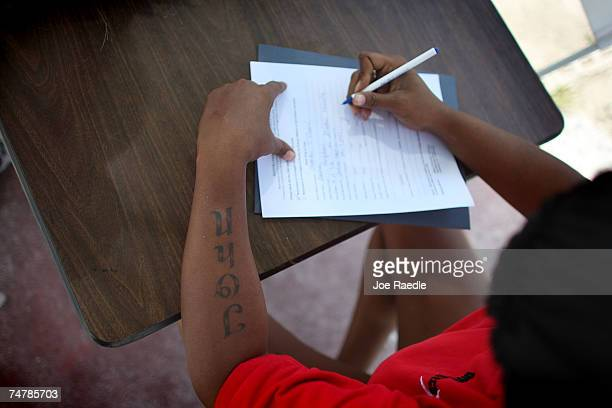 Chekita Conie from Miami, Florida fills out a form applying for restoration of her civil rights on June 19, 2007 in Miami, Florida. Chekita Conie...