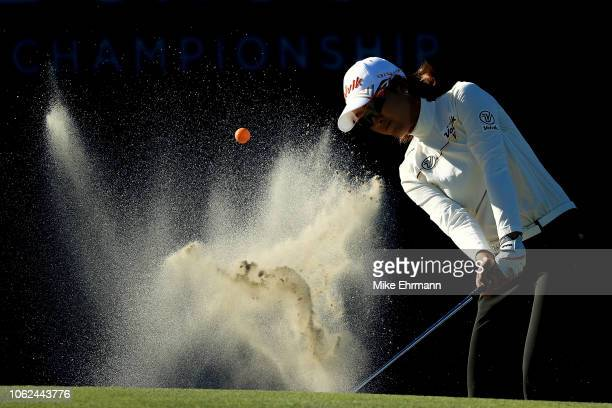 Chella Choi of Korea plays a shot from a bunker on the 18th hole during the second round of the CME Group Tour Championship at Tiburon Golf Club on...