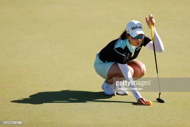 Chella Choi of the Republic of Korea lines up a putt on the first green during the second round of the LPGA LOTTE Championship at Kapolei Golf Club...