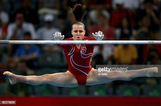 Chellsie Memmel of the United States competes in the uneven bars during the artistic gymnastics team event at the National Indoor Stadium during Day...