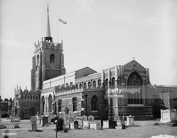 Chelmsford Cathedral in Essex with a St George's Cross flag flying from the spire May 1969