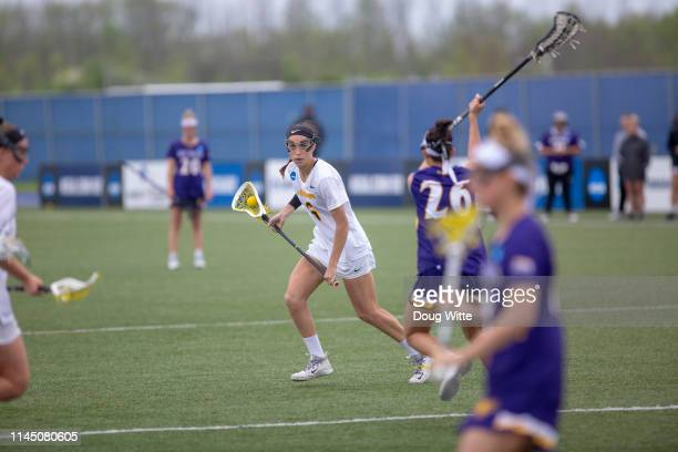 Chelsea Abreu of Adelphi looks to get past West Chesters Brenna Lynch during the Division II Women's Lacrosse Championship held at the GVSU Lacrosse...