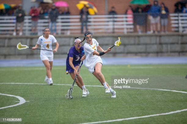 Chelsea Abreu of Adelphi moves past a West Chester defender during the Division II Women's Lacrosse Championship held at the GVSU Lacrosse Stadium on...