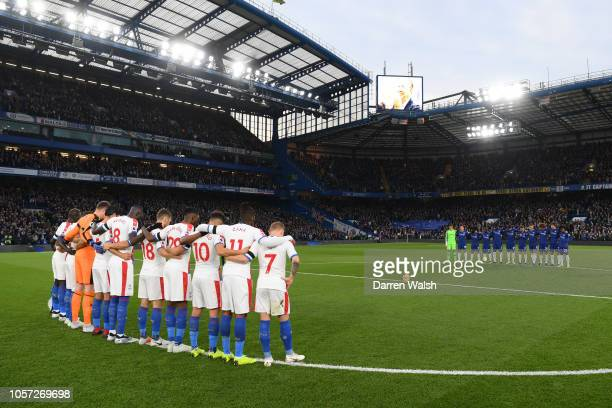 Chelsea and Crystal Palace players observe a minutes silence in memory of Leicester City Chairman Vichai Srivaddhanaprabha prior to the Premier...