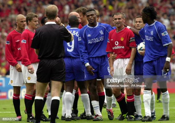 Chelsea and Manchester United players with the referee during the FA Charity Shield at Wembley Stadium London