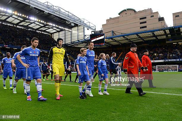 Chelsea and West Bromwich Albion are led out onto the pitch by Chelsea pensioners