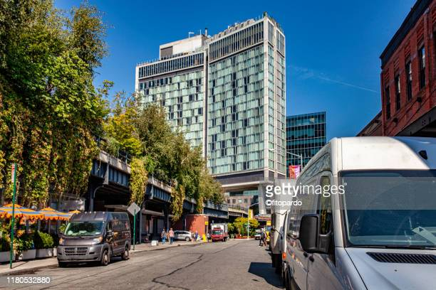 chelsea area and high line park panoramic shot from street level - cosmopolitan nyfw stock pictures, royalty-free photos & images