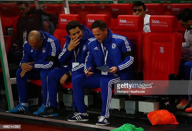 Chelsea assistant manager Steve Holland takes his seat in the dugout next to the vacant seat left by the banned Chelsea manager Jose Mourinho during...