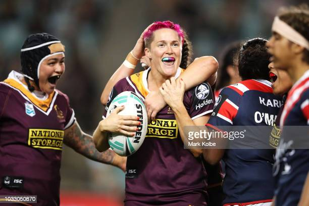Chelsea Baker of the Broncos celebrates with her team mates after victory during the round two Women's NRL match between the Sydney Roosters and the...