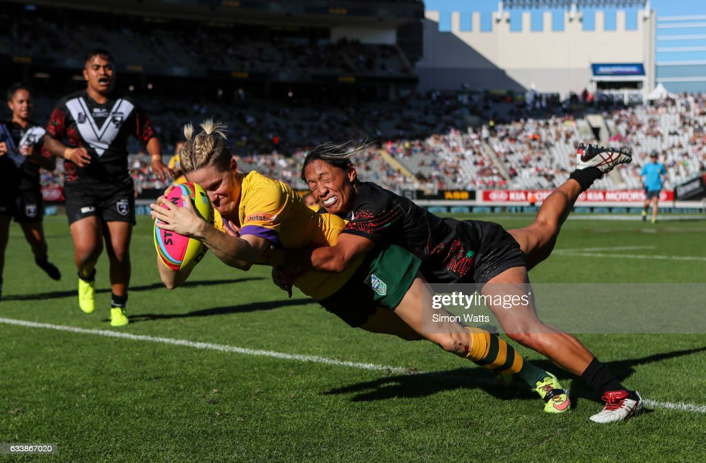 Chelsea Baker of the Jillaroos scores a try as Sarina Fiso of the Kiwi Ferns tackles during the 2017 Auckland Nines match between the Australian Jillaroos and the Kiwi Ferns at Eden Park on February 5, 2017 in Auckland, New Zealand.