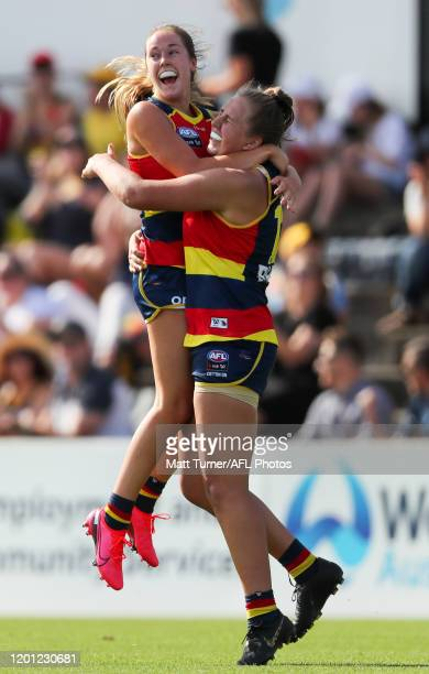 Chelsea Biddell of the Crows celebrates a goal with team mate Madison Newman during the 2020 AFLW Round 02 match between the Adelaide Crows and the...