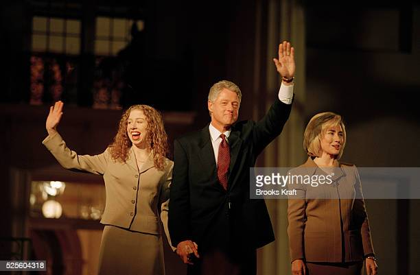 Chelsea, Bill and Hillary Clinton wave to supporters.