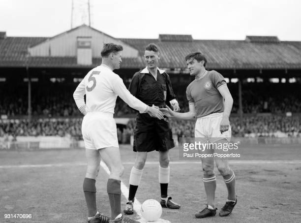 Chelsea captain Bobby Tambling shakes hands with Portsmouth captain Jimmy Dickinson before the match at Stamford Bridge in London, 21st May 1963.