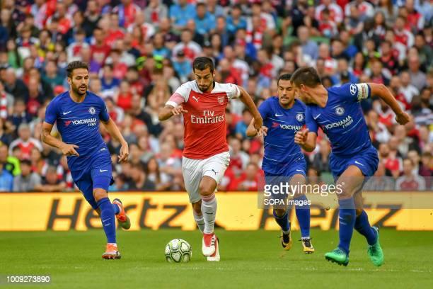 Chelsea captain César Azpilicueta Pedro and Cesc Fabregas chase Arsenal's Henrikh Mkhitaryan during the Chelsea v Arsenal International Champions Cup...