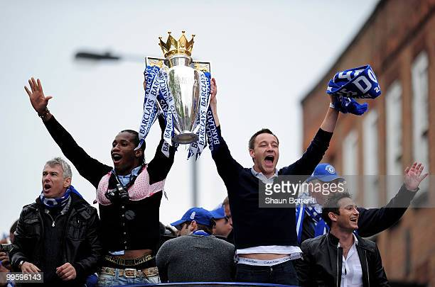 Chelsea captain John Terry and Didier Drogba celebrate with the Premier League Trophy during the Chelsea FC Victory Parade on May 16 2010 in London...