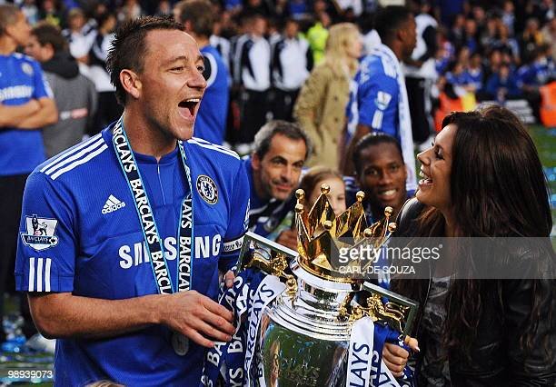 Chelsea captain John Terry and his wife Toni Poole celebrate with the Barclays Premier league trophy after Chelsea win the title with a 80 victory...