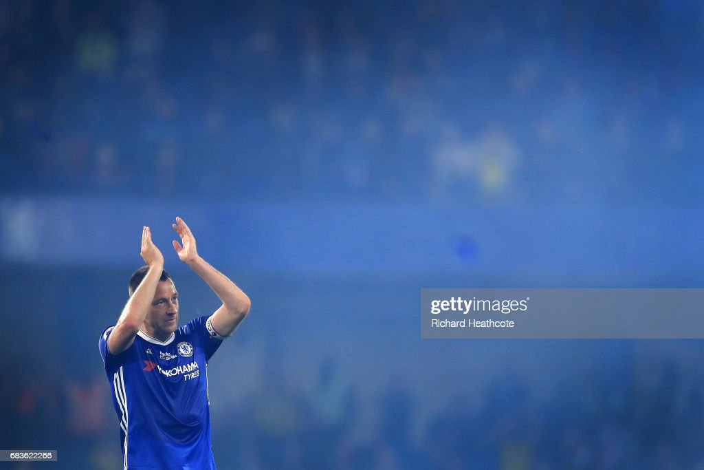 Chelsea captain John Terry applaudes the fans at the end of the Premier League match between Chelsea and Watford at Stamford Bridge on May 15, 2017 in London, England.