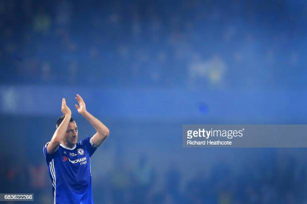 Chelsea captain John Terry applaudes the fans at the end of the Premier League match between Chelsea and Watford at Stamford Bridge on May 15 2017 in...
