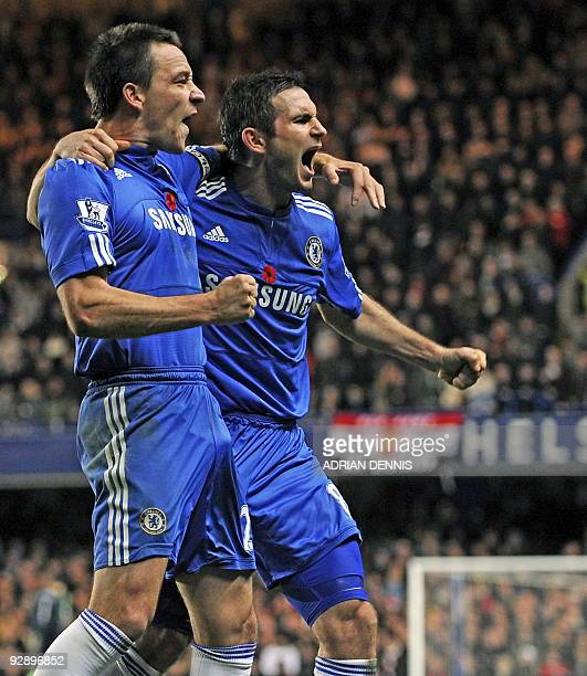 Chelsea captain John Terry celebrates his goal with team-mate Frank Lampard during the English Premier League footbal match between Chelsea and...